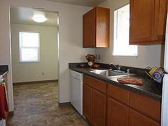 Galley Kitchen with Dining Room